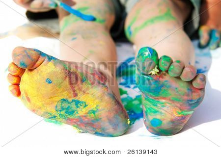 colored child's feet over white