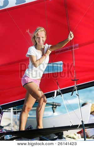 young smiling girl onboard sea yacht