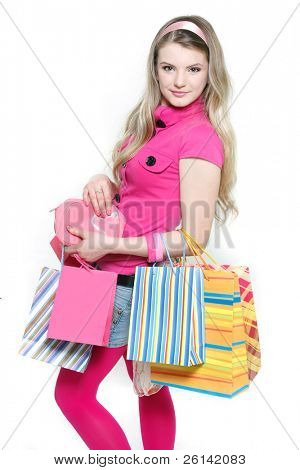 young attractive girl with shopping bags over white