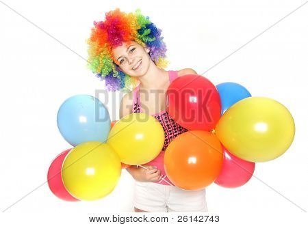 bright studio portrait of happy young woman with balloons