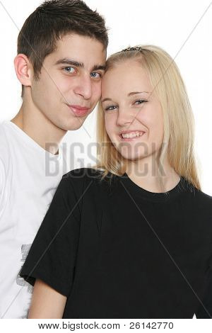 happy teen couple over white