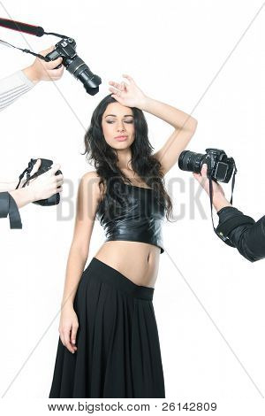 multiple photo cameras taking picture of young beautiful woman over white