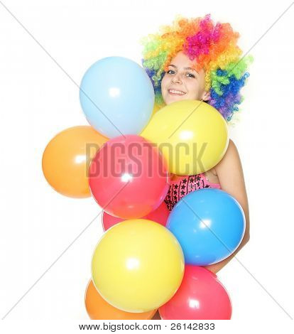 funny young woman with colorful balloons over white