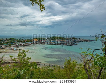 poster of Viewpoint On The Mountain With Fisherman Townscape With Idyllic Ocean And Rainy Cloud Sky In Vacatio