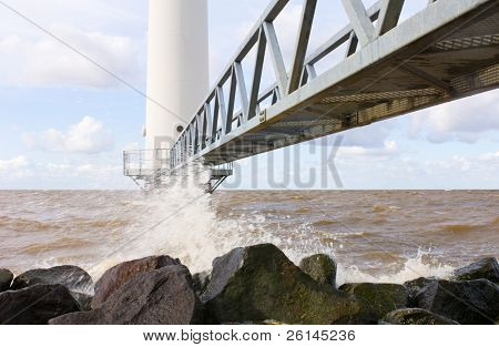 The jetty leading towards the entrance of a wind turbine just off the coast.