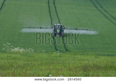 Tractor During The Weed Control