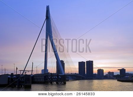 The famous Erasmus Suspension bridge with the Rotterdam skyline in the background against the colours of the setting sun