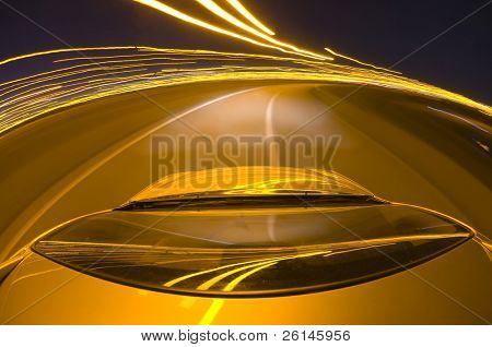 A car driving at high speed around a motorway bend at night