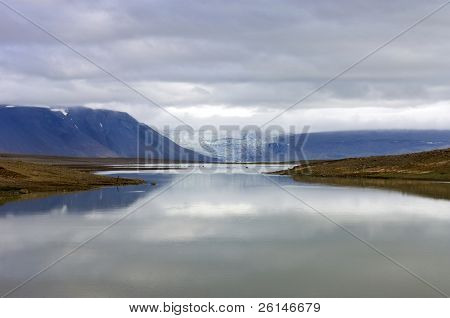 The lake and volcanic landscape around the Kjolur Highland Route with an overcast view on the Langjokull glacier, and the Hvitarvatn Glacier lake in Iceland