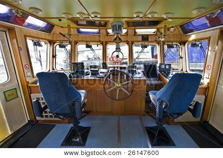 The wheelhouse of a fireboat with various navigational equipment