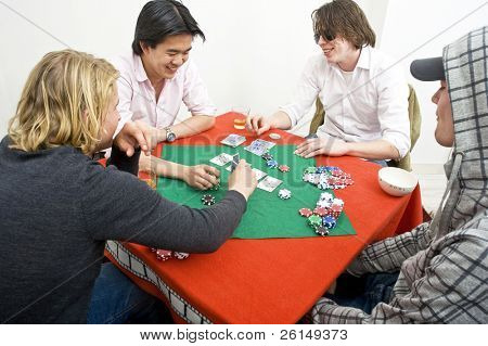 Four men playing a friendly game of backroom poker