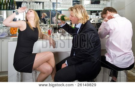 three drunken persons sitting on a bar stool and drinking champagne