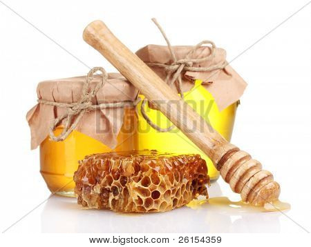 two jars of honey, honeycombs and wooden drizzler isolated on white