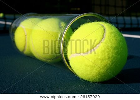 Tennis balls coming out of a cannister