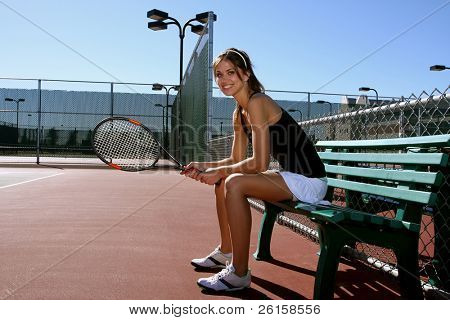 Female Tennis player resting between tennis matches
