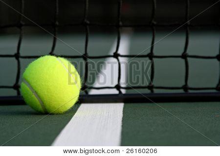 Tennis ball near the net