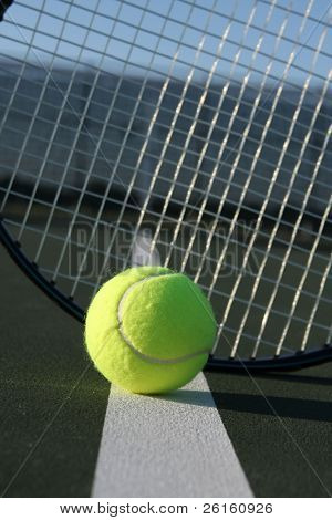 Tennis ball and racket strings