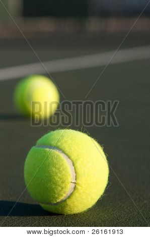 Pair of Tennis Balls on the court with room for copy
