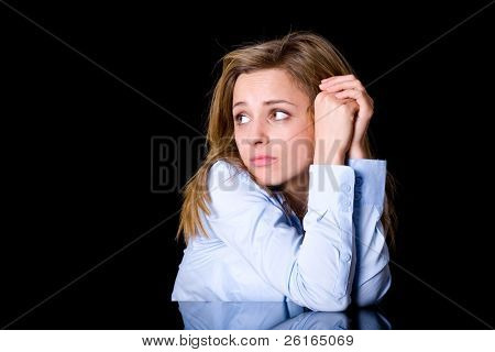 depression, stress, headache concept, young attractive woman in blue shirt holds her head, face expression, studio shoot isolated on black background