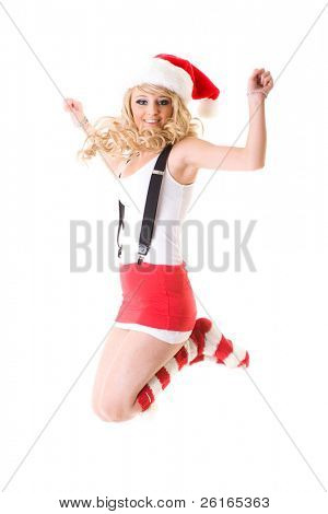 young attractive blonde female santa, red hat and socks, jump, studio shoot isolated on white