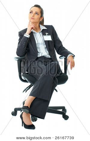 young attractive businesswoman sits on office chair, isolated on white background