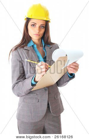 young attractive female architect makes some notes, isolated on white