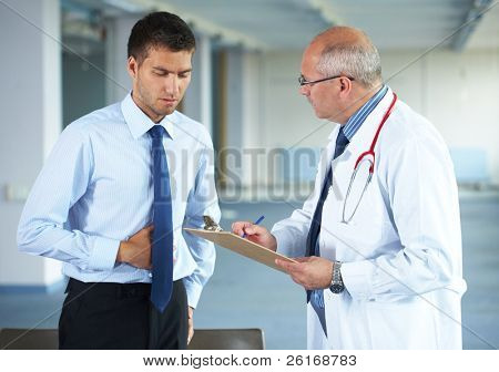 senior doctor and his patient, young male, hospital indoor shoot