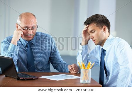 two tired, sad and overworked businessman get a break, and some rest, office shoot
