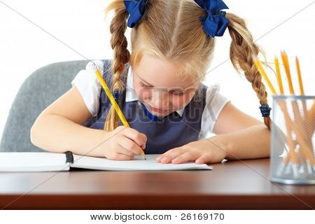 Blonde happy schoolgirl works on her homework, write something in her notepad, isolated on white