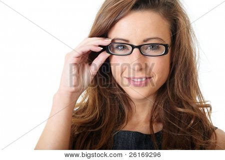Attractive young businesswoman with specs wear grey elegant dress, over white background