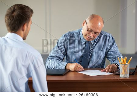 job interview, senior manager and young apprentice isolated on white background