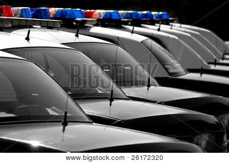 Row of Black and White Police Cars with Blue and Red Lights