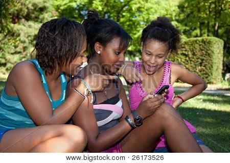 Teenage Black Girls Using A Phone,