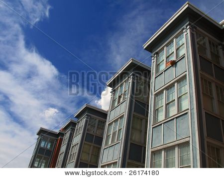 Rows of Apartment Buildings with Blue Sky in Background