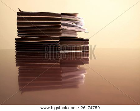 Office desk with files papers and pen