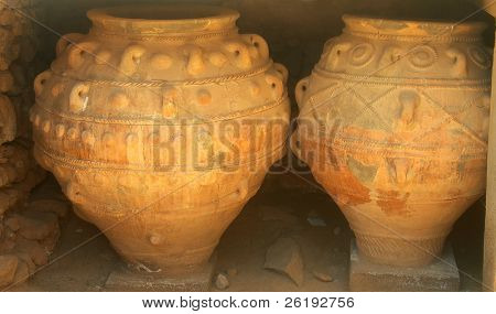Massive Minoan storage jars, restored and on display at Phaistos archaeological site, Crete. They are almost 2 meters high. From about 3,300 years ago.