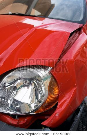 Crumpled wing of a small car after an accident