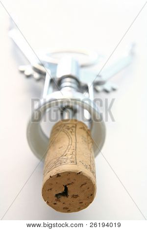 High-key macro of a cork on the end of a corkscrew, shallow depth of field.