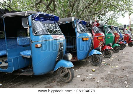 Tuk-tuk minicabs waiting for business in Sri Lanka