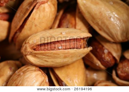 A really huge macro of salted, roasted pistachios. Inevitably, the depth of field is very shallow