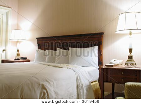 Bedroom With Lamp And King-Size Bed