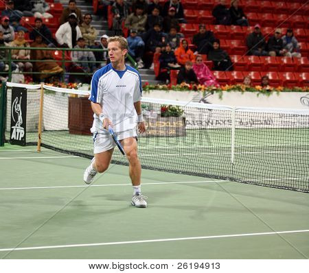 Swedish tennis star Thomas Johansson looks ruefully towards a ball that passed him at the net during his first round defeat, Qatar Open, January 2, 2007