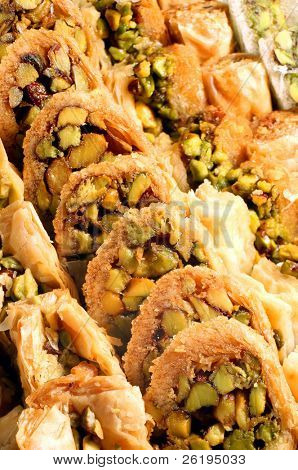 A tray of traditional Lebanese pastries, shot for maximum depth of focus. The pistachio-stuffed product is a popular treat throughout the Middle East.
