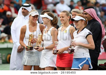 The finalists in the Qatar Total Open doubles with their trophies, on March 3, 2007. From left, winners Maria Kirilenko and Martina Hingis; runners-up Agnes Szavay and Vladimira (Vladka) Uhlirova