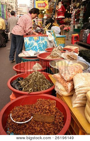 Silkworm larvae and other Far Eastern delicacies on sale at a street market in Seoul, South Korea.