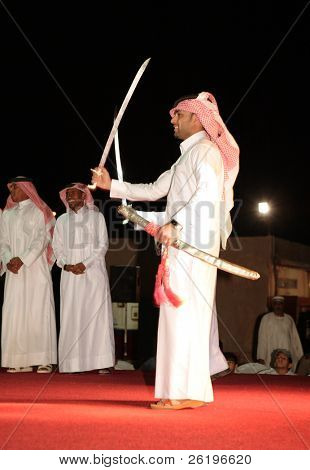 Members of a Qatari folk troupe performing the traditional Bedouin sword dance, the Arda, during Doha Cultural Week, 2008