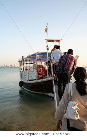 Fun seekers board a pleasure dhow at the Corniche in Doha Bay, Qatar, in 2008. Dhow trips around the bay are a cheap and relaxing entertainment