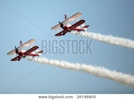 LOWESTOFT, Suffolk - July 24, 2008: Team Guinot air display team, the world's only formation wingwalkers, in action at the Lowestoft Air Show. The show is a major annual aviation event