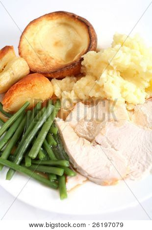 A festive dinner with turkey breast, green beans, roast and mashed potatoes and yorkshire pudding