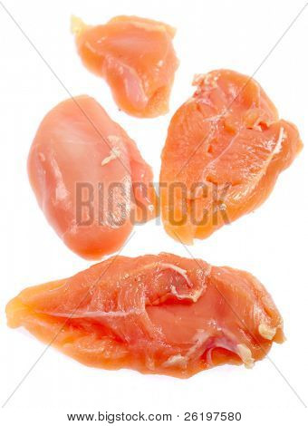 Raw chicken half-breasts over white, vertical, viewed from above